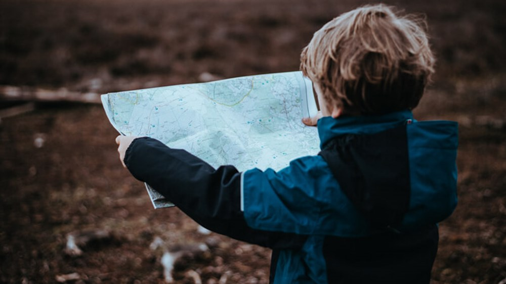 Child reading map | Wealthify